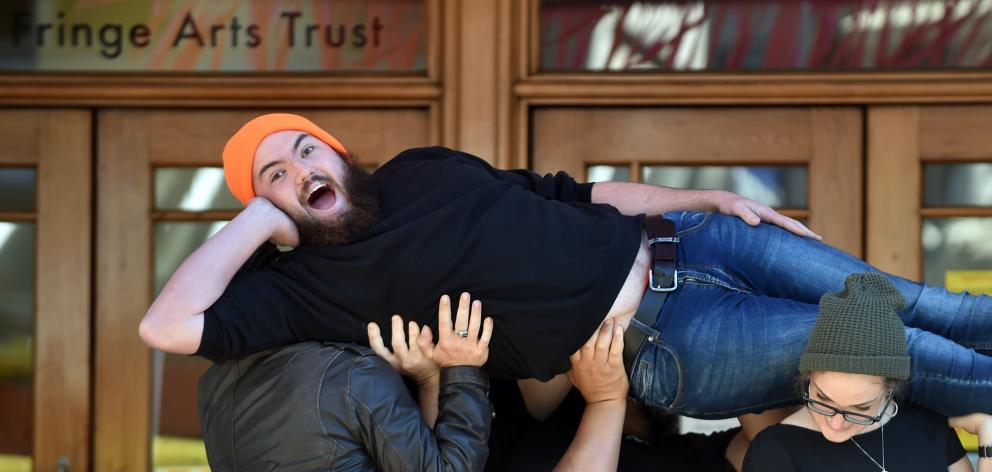 Comedian Cameron McLeod as his alter-ego Steve is lifted outside Dunedin Fringe Festival headquarters yesterday. Photo by Peter McIntosh.