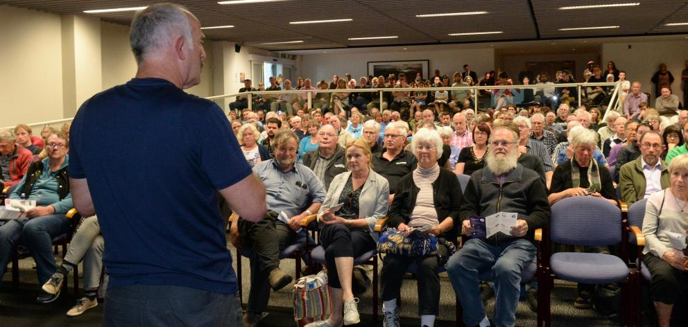 Gareth Morgan speaks to a packed audience at the Otago Museum's Hutton Theatre last night. Photo by Linda Robertson.