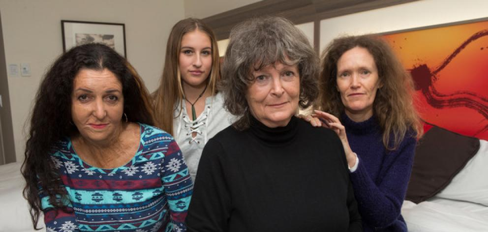 Maggie Wilkinson wants an inquiry into forced adoption.She is pictured with daughters Vivienne...
