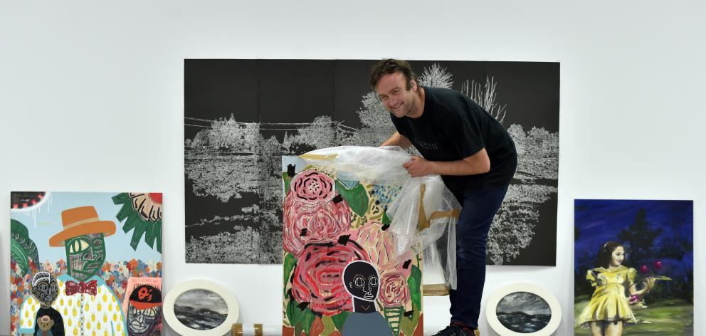 Dunedin City Council Ara Toi project co-ordinator Antony Deaker with works of art by Yonel Watene, which are bound for an exhibition in the Yu Gallery, in Shanghai.