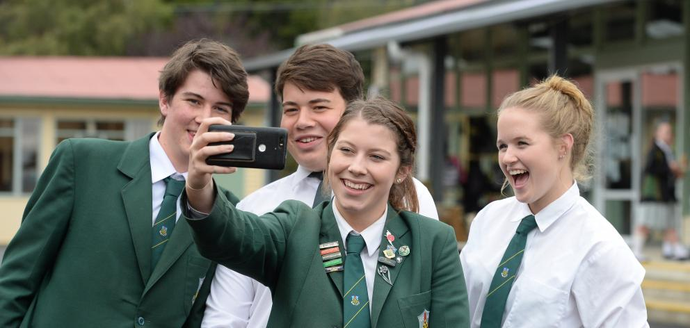 Taking a selfie together are East Otago High School pupils (from left) Jamie Dodd (17), Breeshyn Witehira (17), Hayley Jenkinson (16) and Nicole Bungard (17). Photo by Linda Robertson.