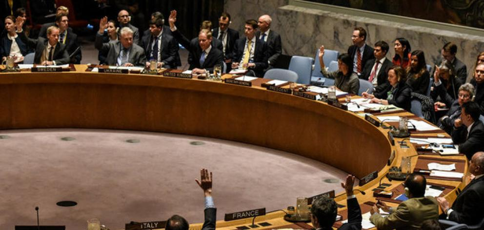 Members of the security council vote for a draft resolution condemning the reported use of chemical weapons in Syria. Photo: Reuters