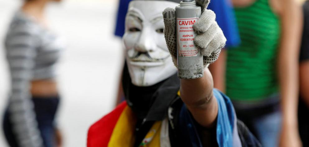 The marchers gathered at more than two dozen points around Caracas, although some were stalled by authorities closing around 20 subway stops. Photo: Reuters