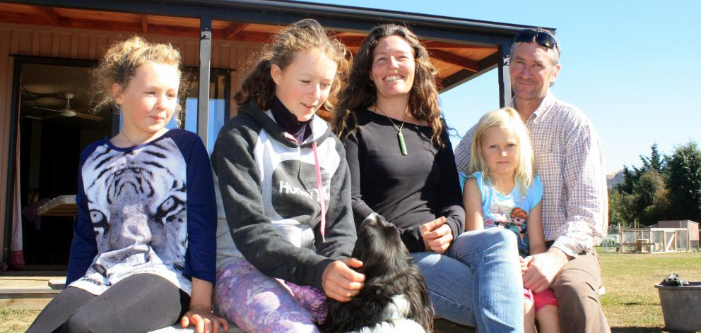 Enjoying the sun outside their home in Luggate are (from left) Ana,  Taila,  Amelia, Penni,  and...