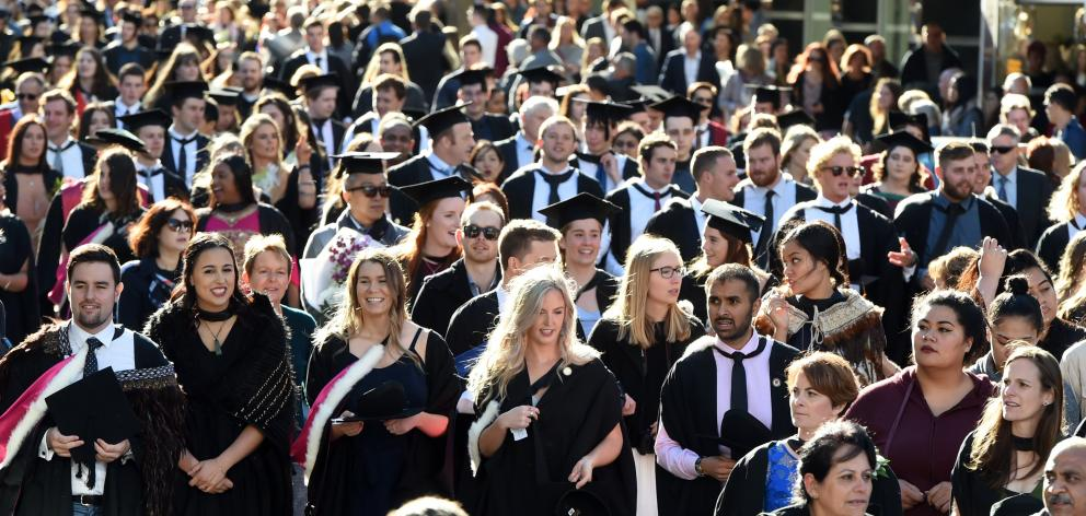 Graduands march down George St towards the Dunedin Town Hall where two University of Otago graduation ceremonies were held on Saturday. They were among about 600 graduands who received degrees and diplomas in applied science, biomedical sciences, physical