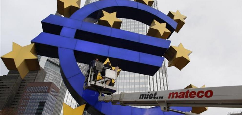 The European Central Bank in Frankfurt, which it is hoped will cut its base lending rate and buy...