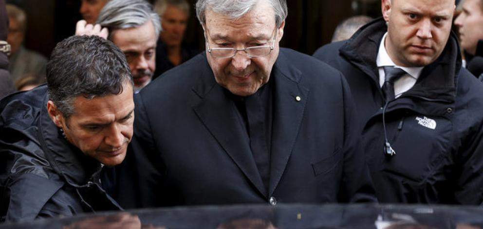 Australian Cardinal George Pell leaves at the end of a meeting with the victims of sex abuse in Rome. Photo: Reuters