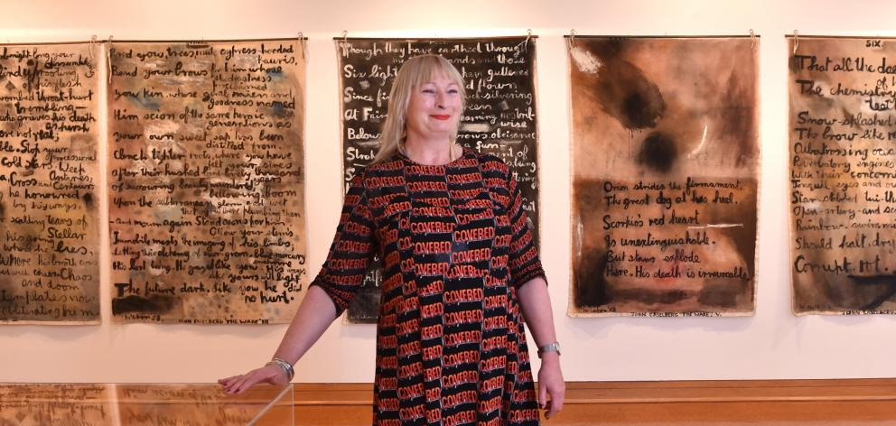 Robyn Notman, the Hocken's new head curator, pictorial collections, in front of Colin McCahon's 16-piece The Wake, which carries a poem by John Caselberg, the Burns Fellow for 1961. Photo: Peter McIntosh