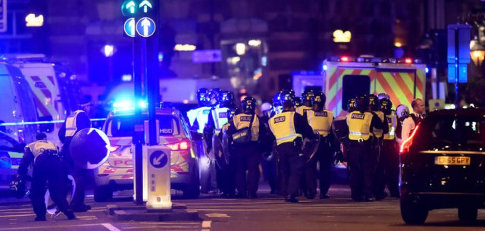 Police are rushing to London Bridge after several reports of a van running into pedestrians. Photo: Reuters