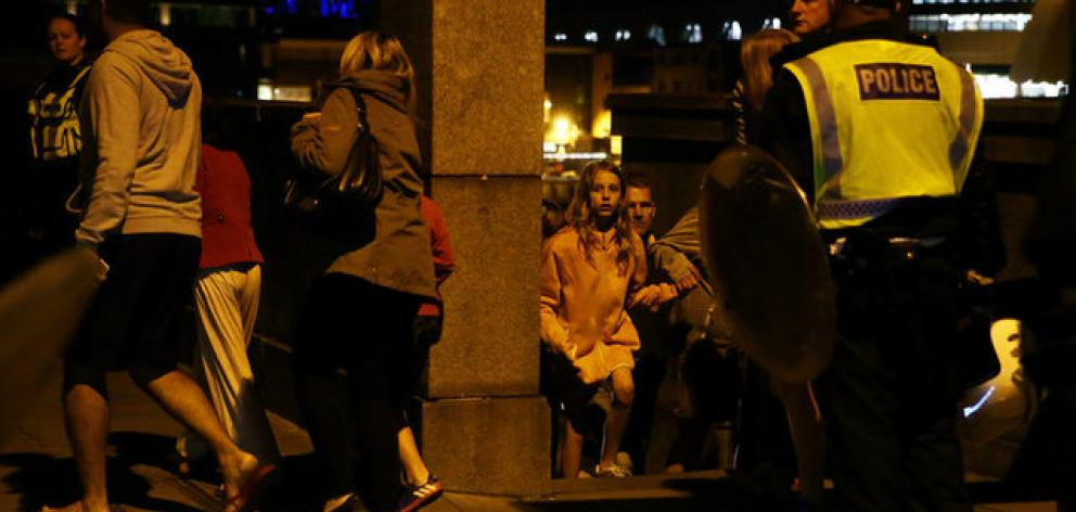 People flee as police attend to an incident near London Bridge in London. Photo: Reuters