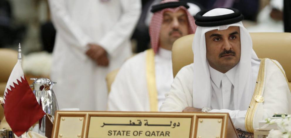 The Emir of Qatar Tamim bin Hamad al-Thani attends the final session of the South American-Arab Countries summit, in Riyadh. Photo: Reuters