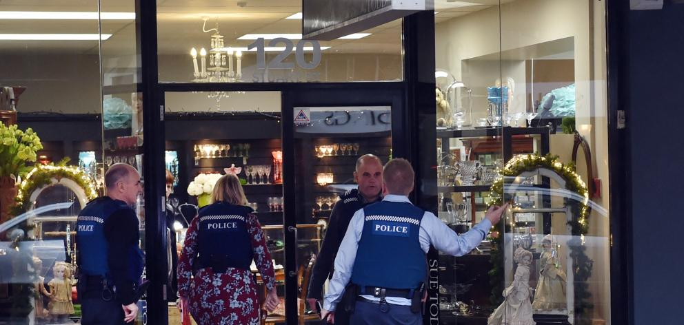 Police enter Sue Todd Antiques  in Stuart St after an alleged robbery about 3.45pm yesterday....