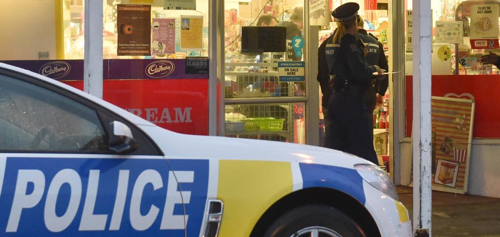 Police at the scene of a robbery at the Elgin Food Market in Mornington on Friday.