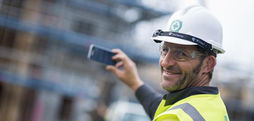 Otago Polytechnic graduate Mark Henry trials the ITAB App for apprentices. PHOTO: HAYDEN PARSONS