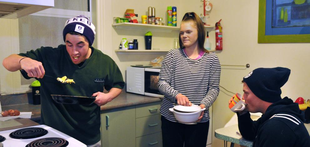 Bradley Quine (18), Kate Hyslop (17) and Karl Northey (19) cook dinner in their Dunedin flat last...