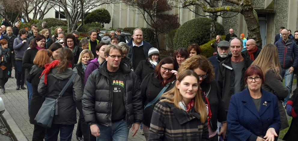 University of Otago general staff file back to work after a meeting where they were told 182 jobs...
