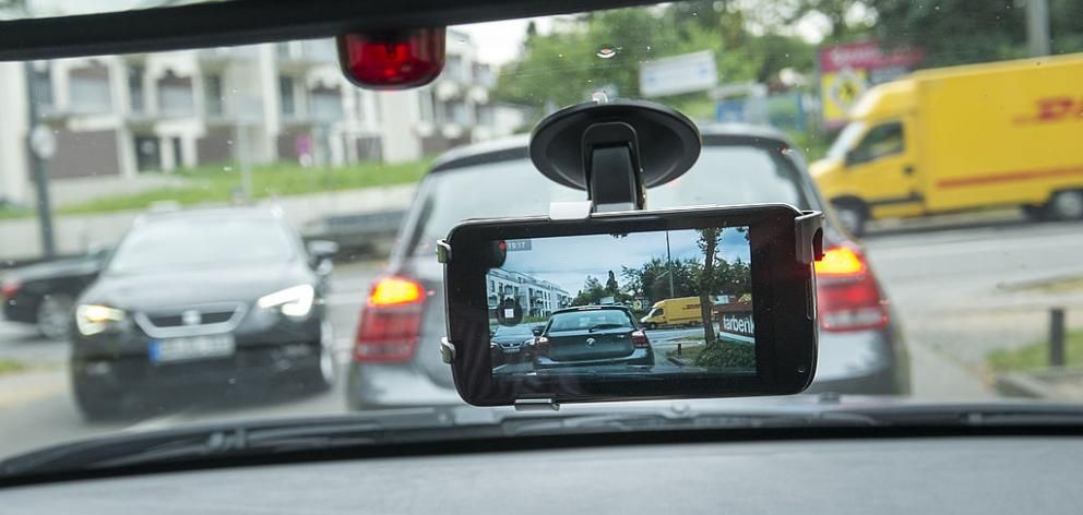 Phone recording on car's dashboard. Photo: Getty
