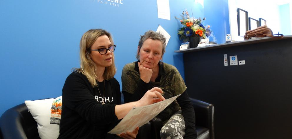Wanaka osteopath Liana Poole (left) and Claire O'Connell discuss Ferdia O'Connell's treatments....