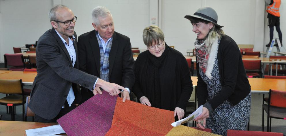 At the site of the South Dunedin pop-up library and community hub are (from left) Cargill...