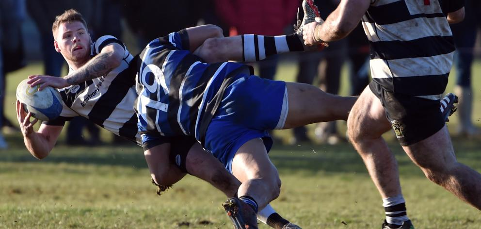 Kaikorai loose forward Iakopo Petelo Mapu nails Southern winger Josh Buchan in a good tackle...