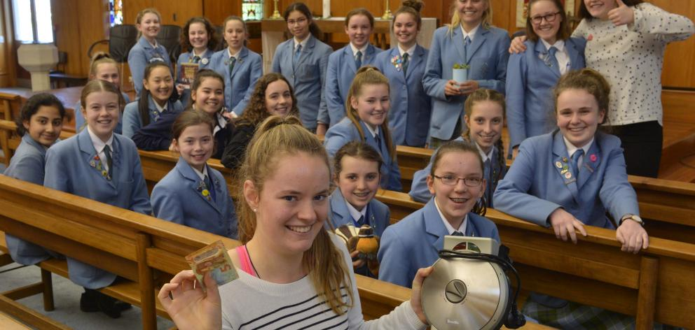 St Hilda's Collegiate pupil Meg Kinney (front) led a group who made breakfast, including waffles,...