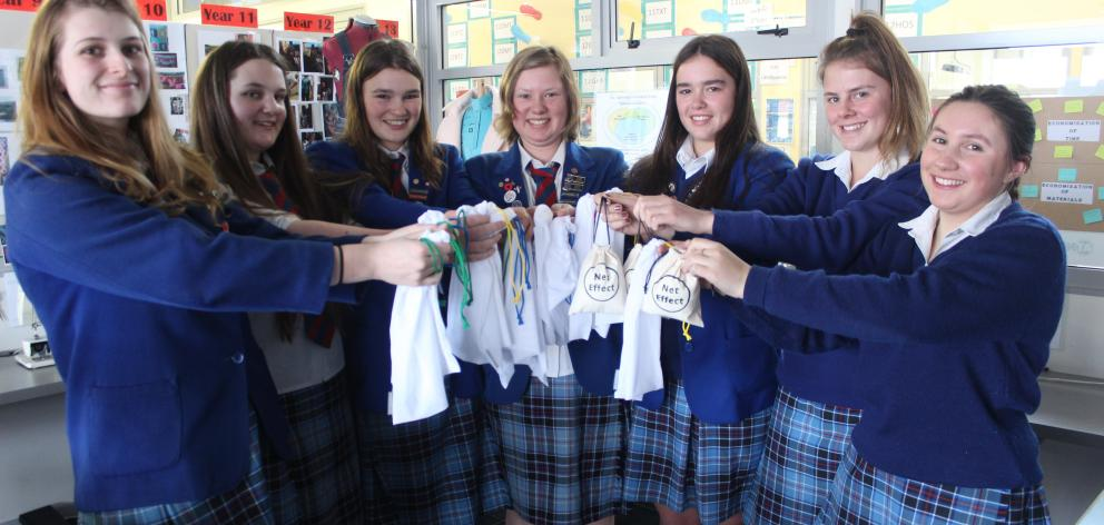 South Otago High School pupils (from left) Abbey Mills (16), Charlotte Ellis (16), Alice Murray (17), Briar Mills (16), Kayley Johnson (16), Chrystal Wrigley (16) and Olivia Clark (16) with the reusable produce mesh bags they are selling for their Young E