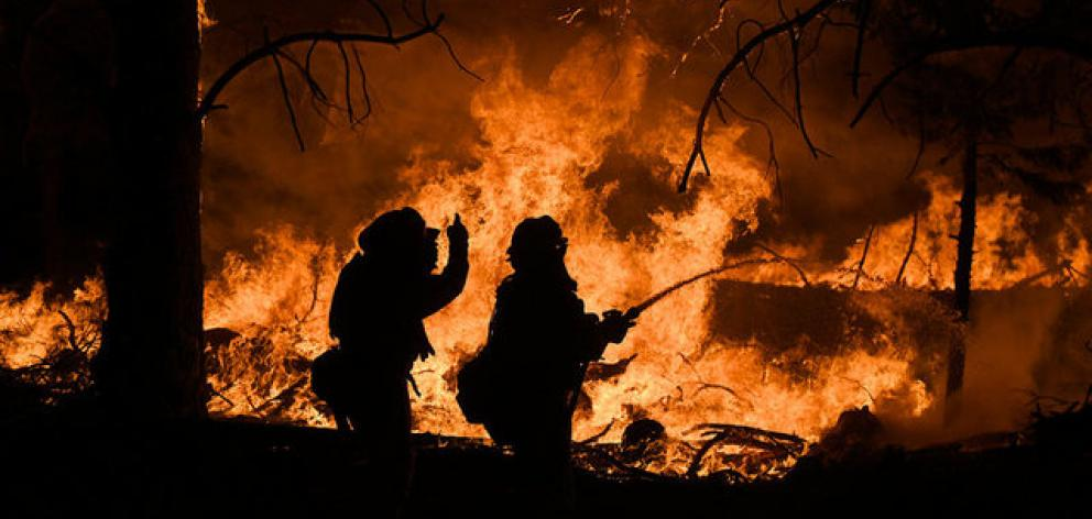 Firefighters battle the Ponderosa Fire east of Oroville. Photo: Reuters