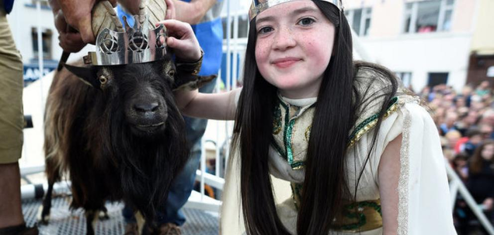 Puck Queen Caitlin Horgan poses with the newly crowned King Puck goat. Photo: Reuters