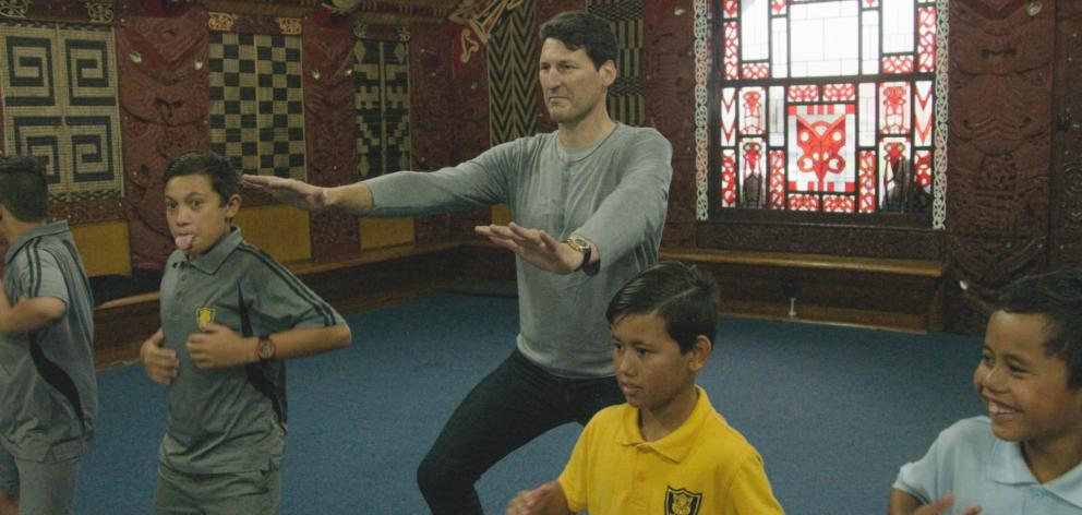 Former Wallaby captain John Eales learns a haka as part of the documentary 'John Eales Reveals: The Haka'. Eales described the experience as ''very uncomfortable''. Photo: Supplied