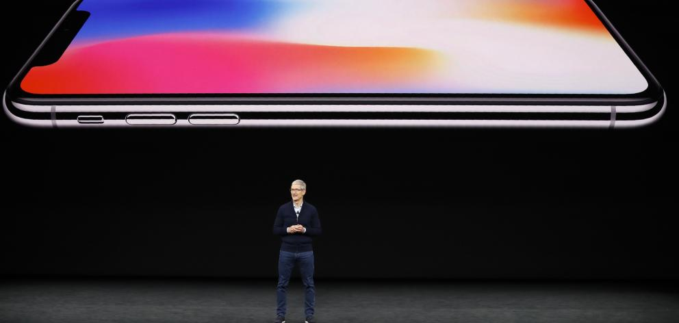 Apple chief executive Tim Cook launches the new iPhone X. Photo: Reuters