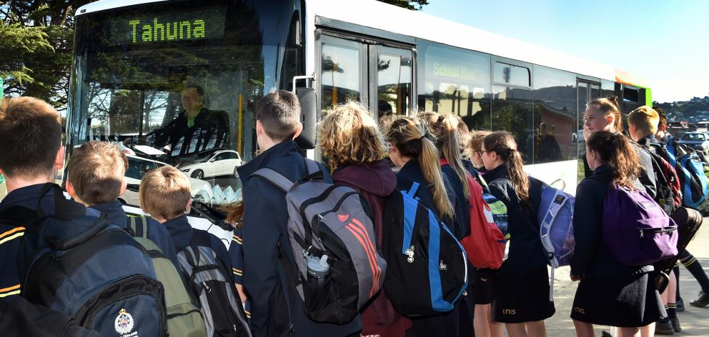 Tahuna Intermediate School pupils queue to board the Go Bus service to Portobello. Photo: Peter McIntosh