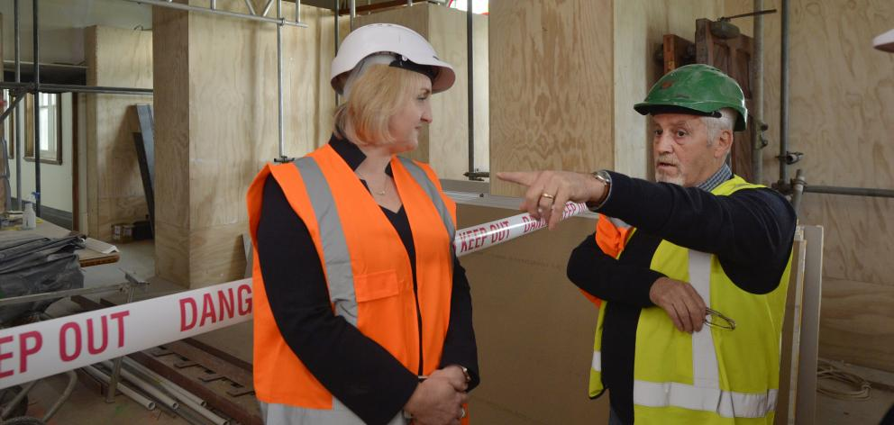Courts Minister Amy Adams is shown around the Dunedin Courthouse by project manager Jeff Halmshaw...