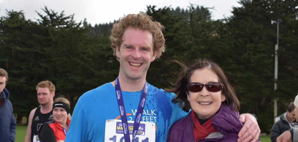Damian Hill and mother Denise Hill, both of Dunedin, at the finish of the half-marathon. Photo:...