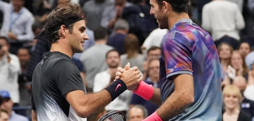 Roger Federer of Switzerland (left) greets Juan Martin del Potro of Argentina after their match on day ten of the US Open. Photo: Robert Deutsch-USA TODAY Sports