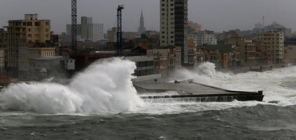 Waves crash against the seafront boulevard El Malecon as Hurricane Irma turns toward the Florida Keys. Photo: Reuters