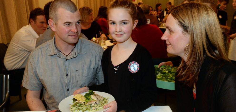 Mineeka Macshane-Camp (8)  serves a meal to her parents, Tim Camp and Charlotte Macshane, at  the...