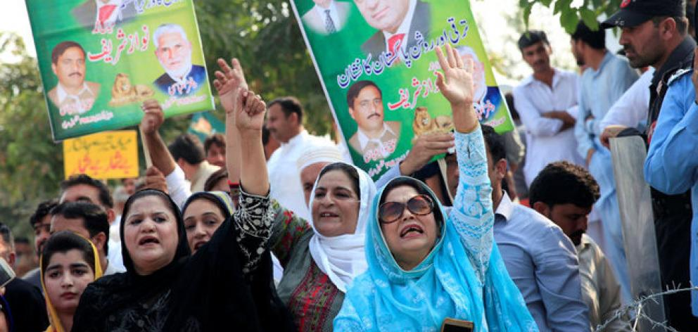 Supporters of Pakistan's former Prime Minister Nawaz Sharif chant slogans during his appearance before the accountability court in connection with the corruption references filed against him. Photo: Reuters