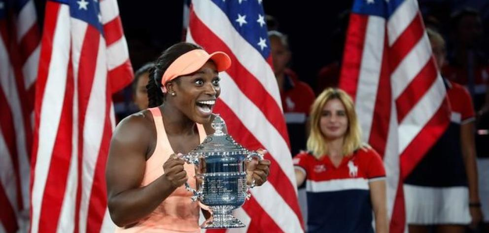 Sloane Stephens of the United States reacts with the trophy after defeating fellow American Madison Keys. Photo: Reuters