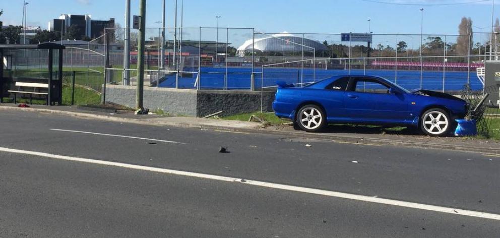 The car at the scene of the crash. Photo: NZ Herald / Doug Sherring