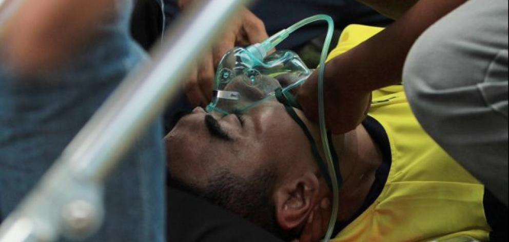 The 38-year-old was taken off the pitch on a stretcher after losing consciousness. Photo: Antara Foto/Rahbani Syahputra via Reuters