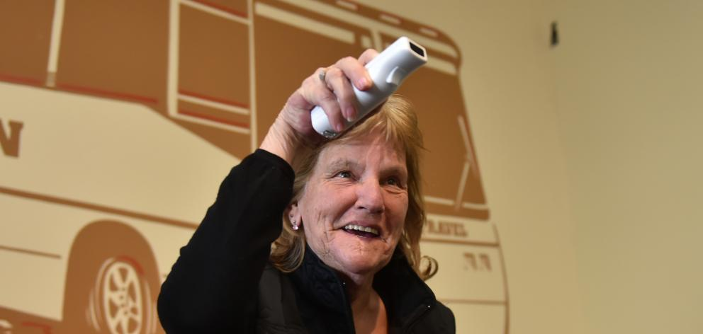 Janice Stevenson, of Dunedin, tries out a Nintendo Wii at the Age Concern Otago expo at the South...