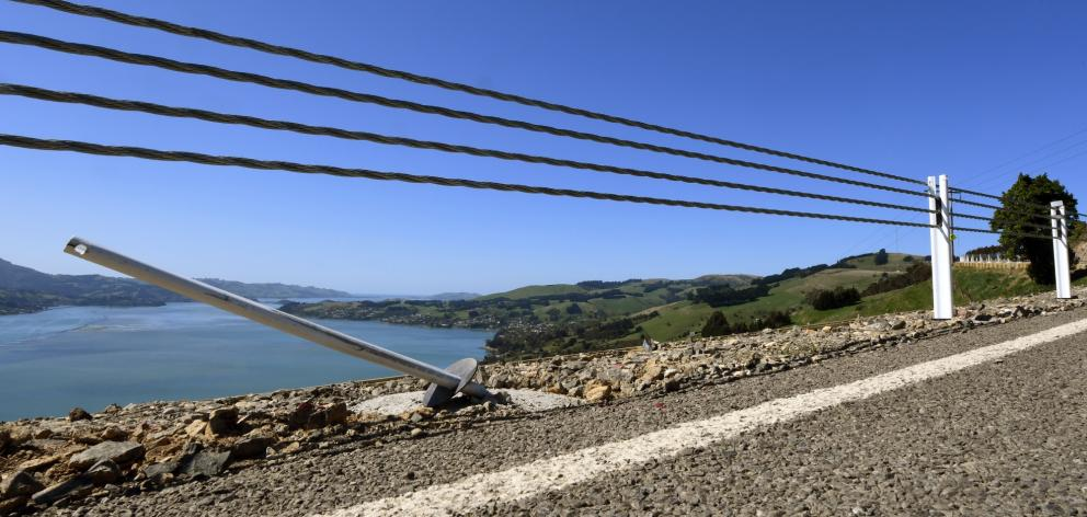 A wire barrier at the edge of a steep drop on Highcliff Rd appears to have saved its first...