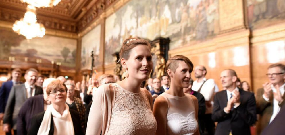 Same-sex couples are seen after getting married during a media call at the town hall after the German parliament approved marriage equality in a historic vote. Photo: Reuters