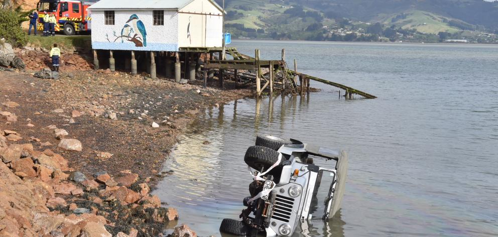 The Jeep crashed in to Otago Harbour just after 9am today. Photo: Gregor Richardson