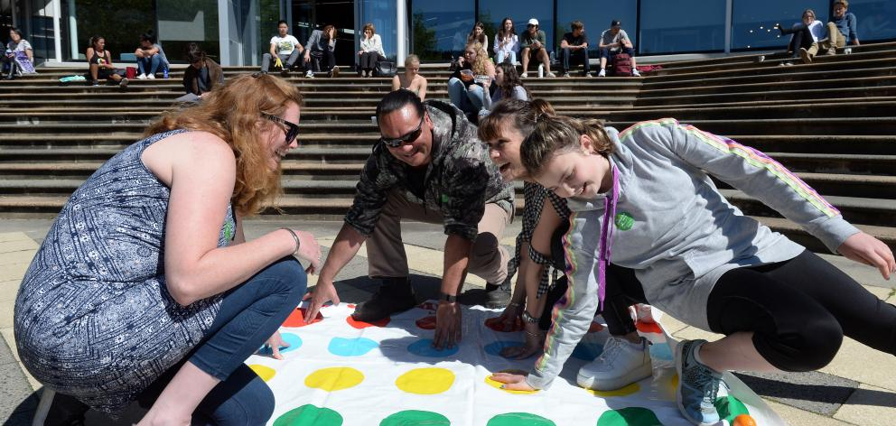 "Playing Twister during a staff ""lockout'' at Otago Polytechnic are (from left) Debz Cracknell, Jade Morgan, Suzie Bartlett and Paige Brown (12). Photo: Linda Robertson"