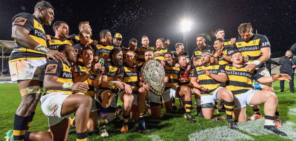 Captain Angus Ta'avao of Taranaki and his team mates pose with the Ranfurly Shield their win against Canterbury on October 6, 2017 in Christchurch. Photo: Getty Images