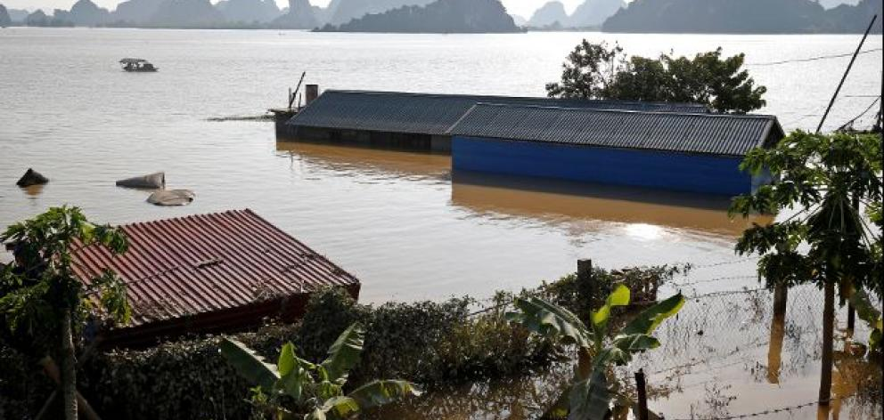 Submerged houses are seen at a flooded village after a heavy rainfall caused by a tropical depression in Ninh Binh province. Photo: Reuters