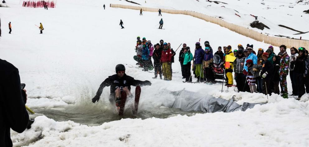 Heath Richmond skims over a pond during an adventure race yesterday on the last day of the  ski...