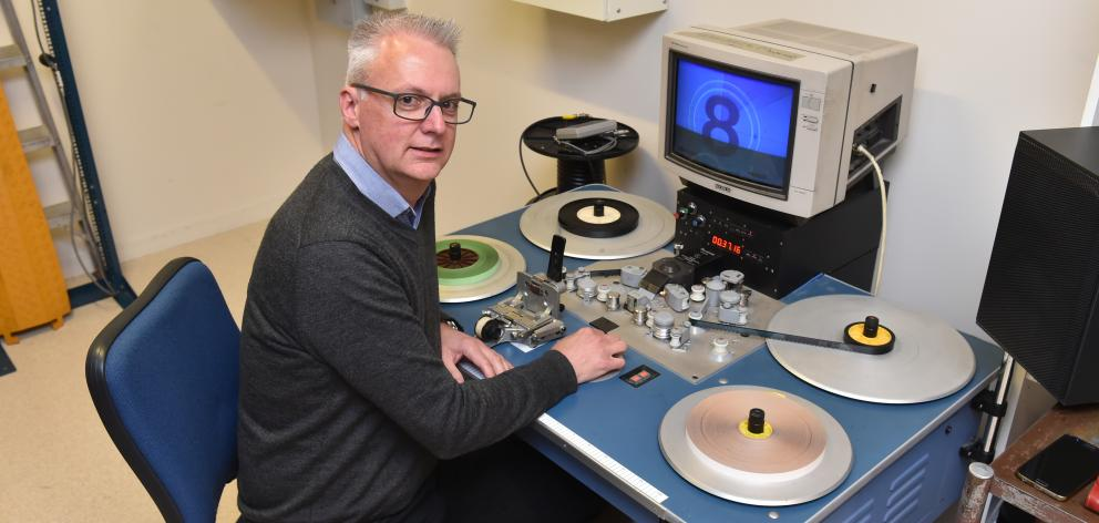NHNZ technical and IT systems manager Wayne Poll plays with an old editing desk at the company's...