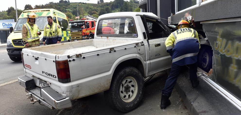 The ute which ploughed into the building of neighbouring businesses Carpet Flooring Xtra and...